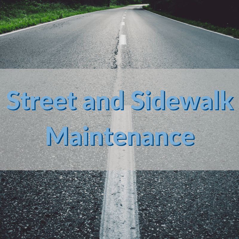 A neighborhood street with the words Street and Sidewalk Maintenance