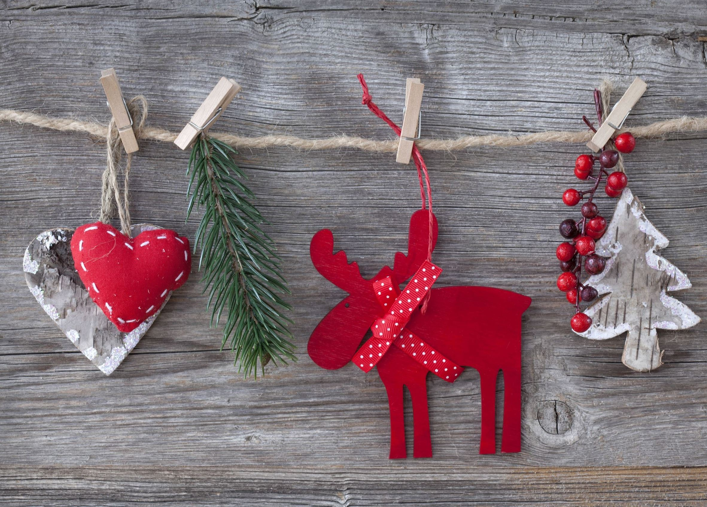 Close up of Christmas Decorations including hearts, pine branch, reindeer, berries, and Christmas tr