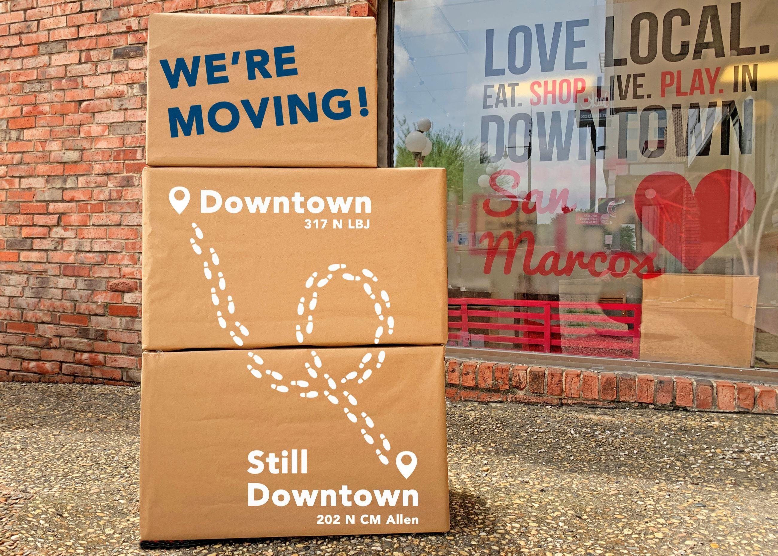 "Photo of moving boxes with ""Main Street is Moving!"" written on them"
