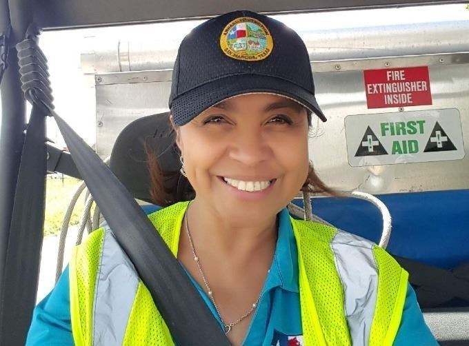 Mary Medina in a safety vest in an atv and smiling