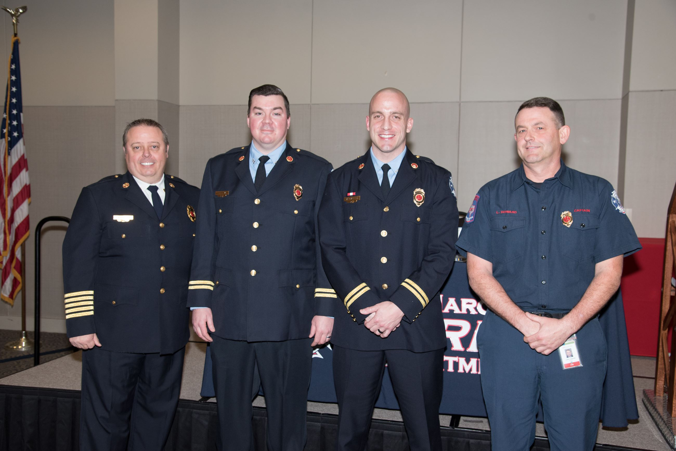 Promotional Pinning for Captains Aaron Stewart, Brian Quackenbush, and Larry Howard