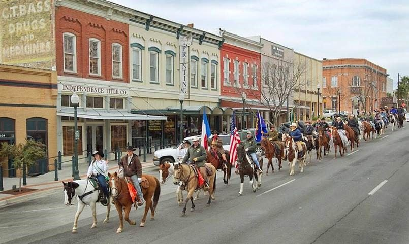 Trail riders parading through downtown