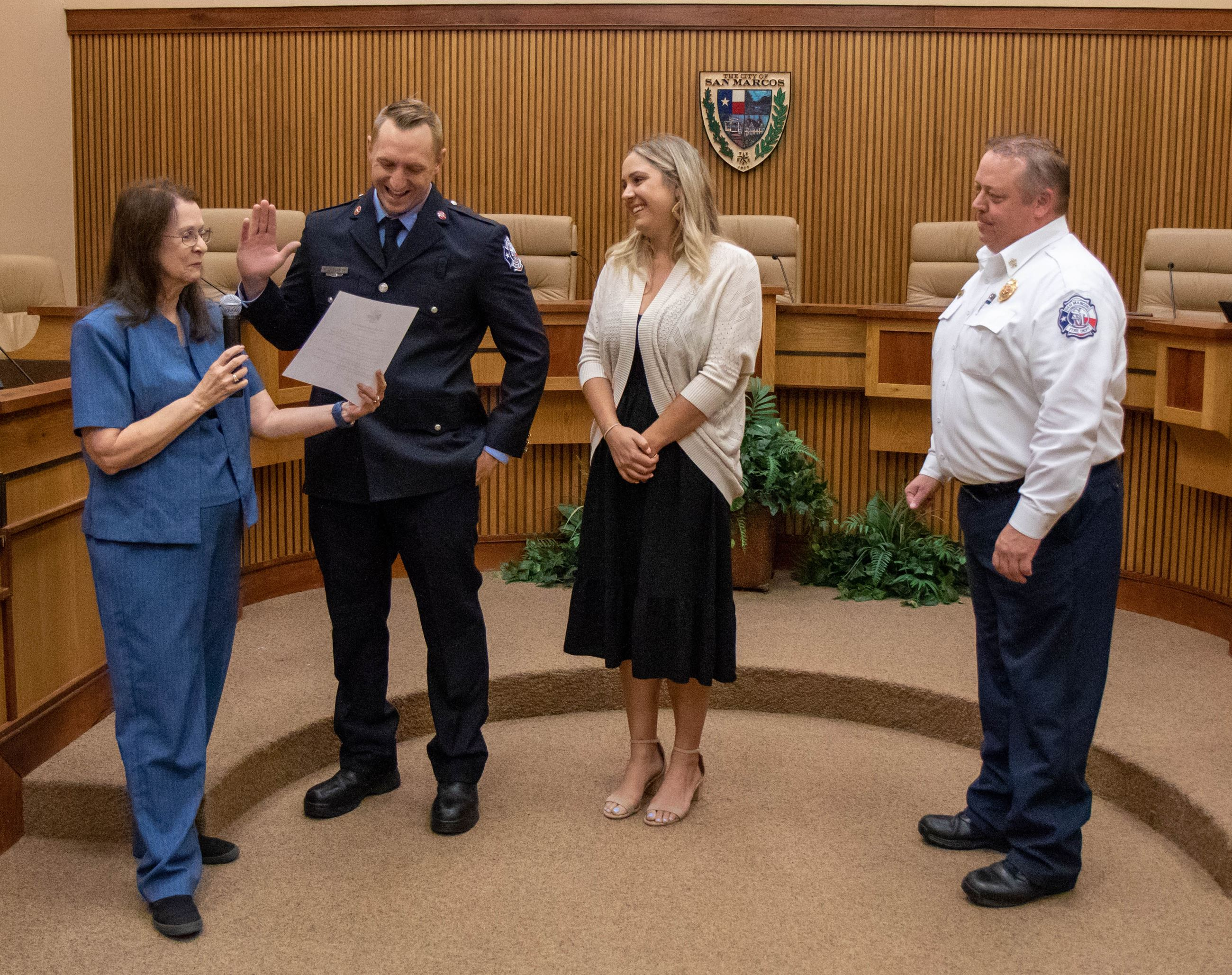 Mayor Hughson & Chief Stephens perform the official Oath of Office with Firefighter Rudy Blasich