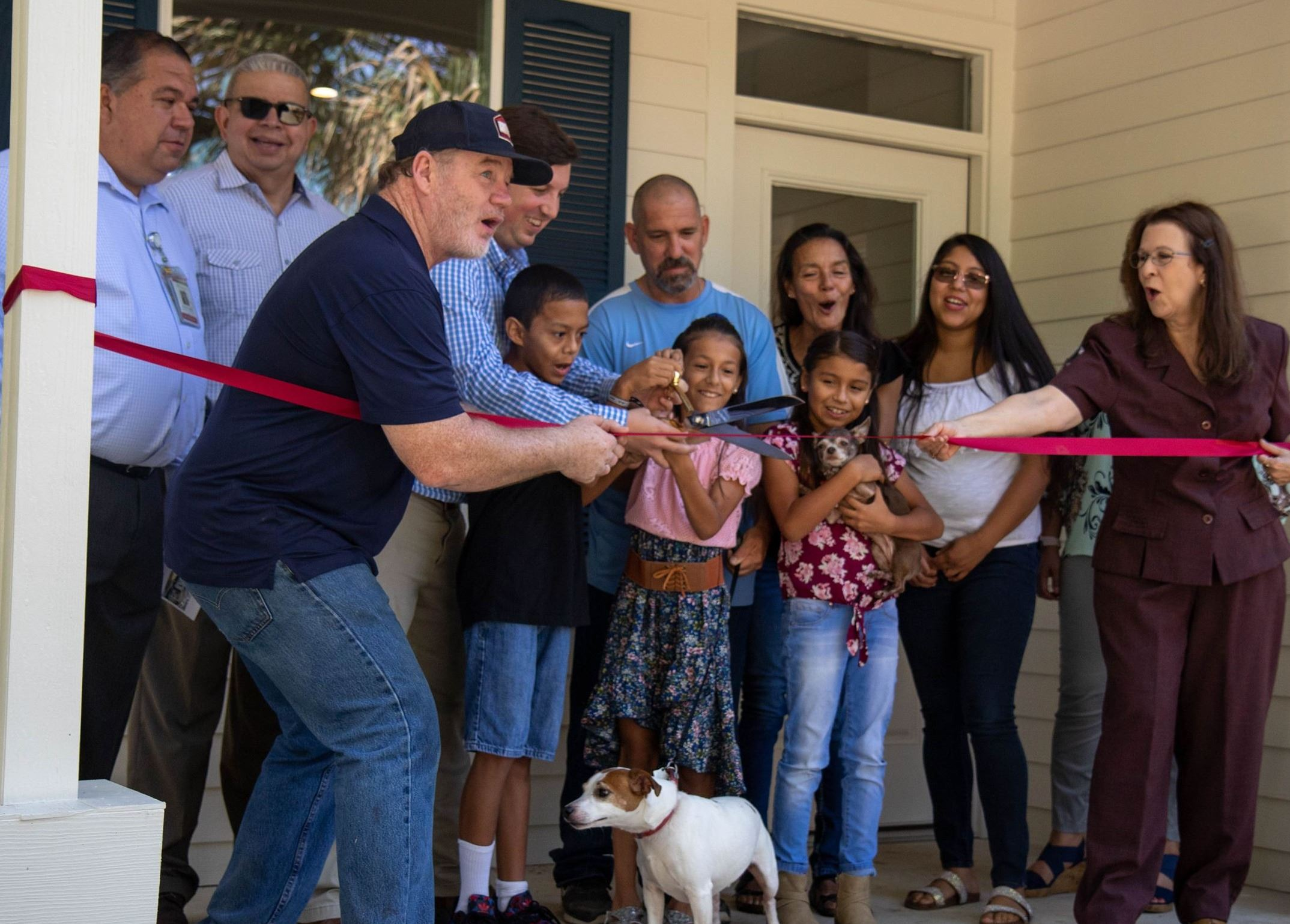 Leadership from the City of San Marcos and DSW Homes join the LaFrance family to cut a red ribbon st