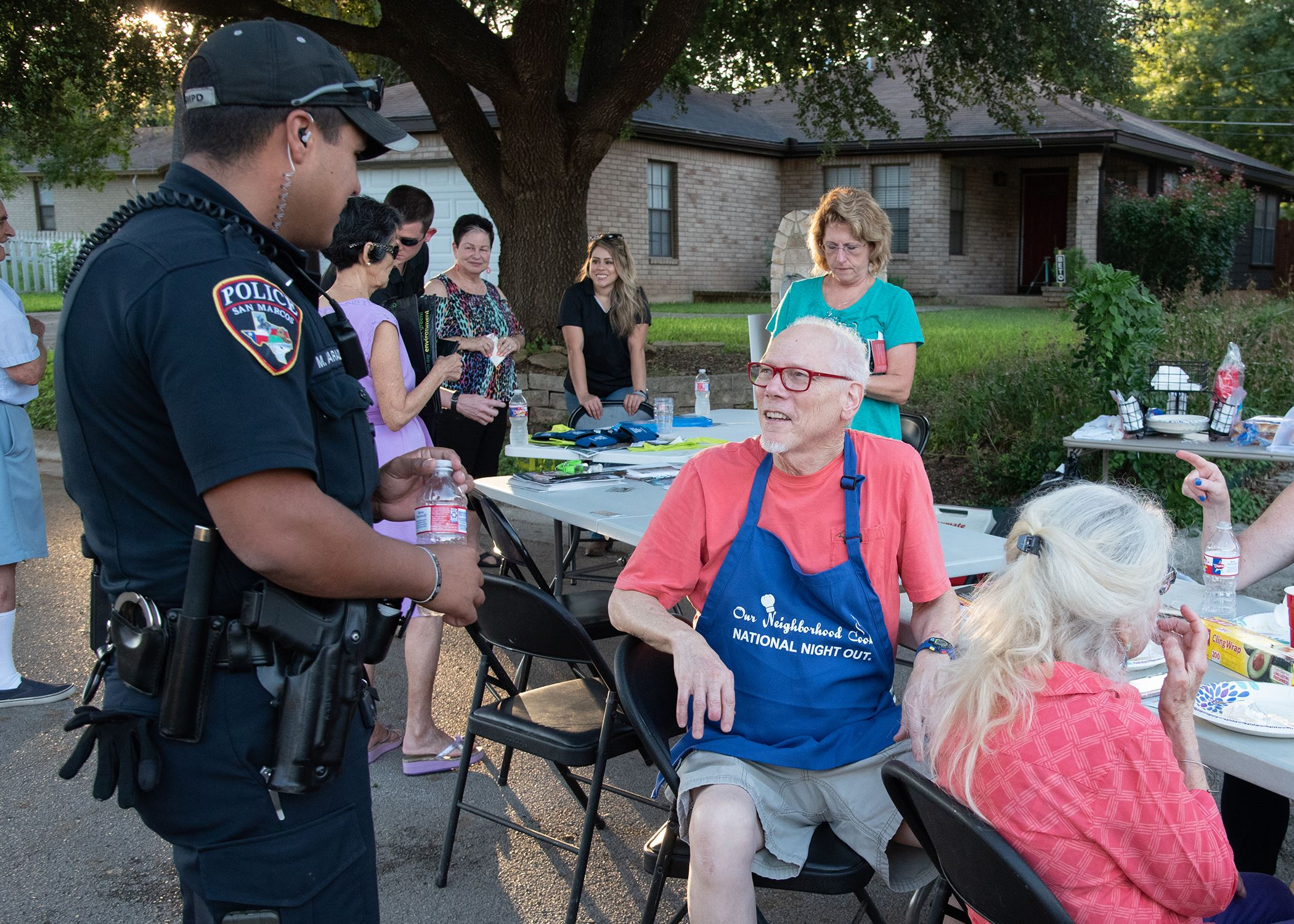 Photo of neighbors talking to police officer during National Night Out 2018