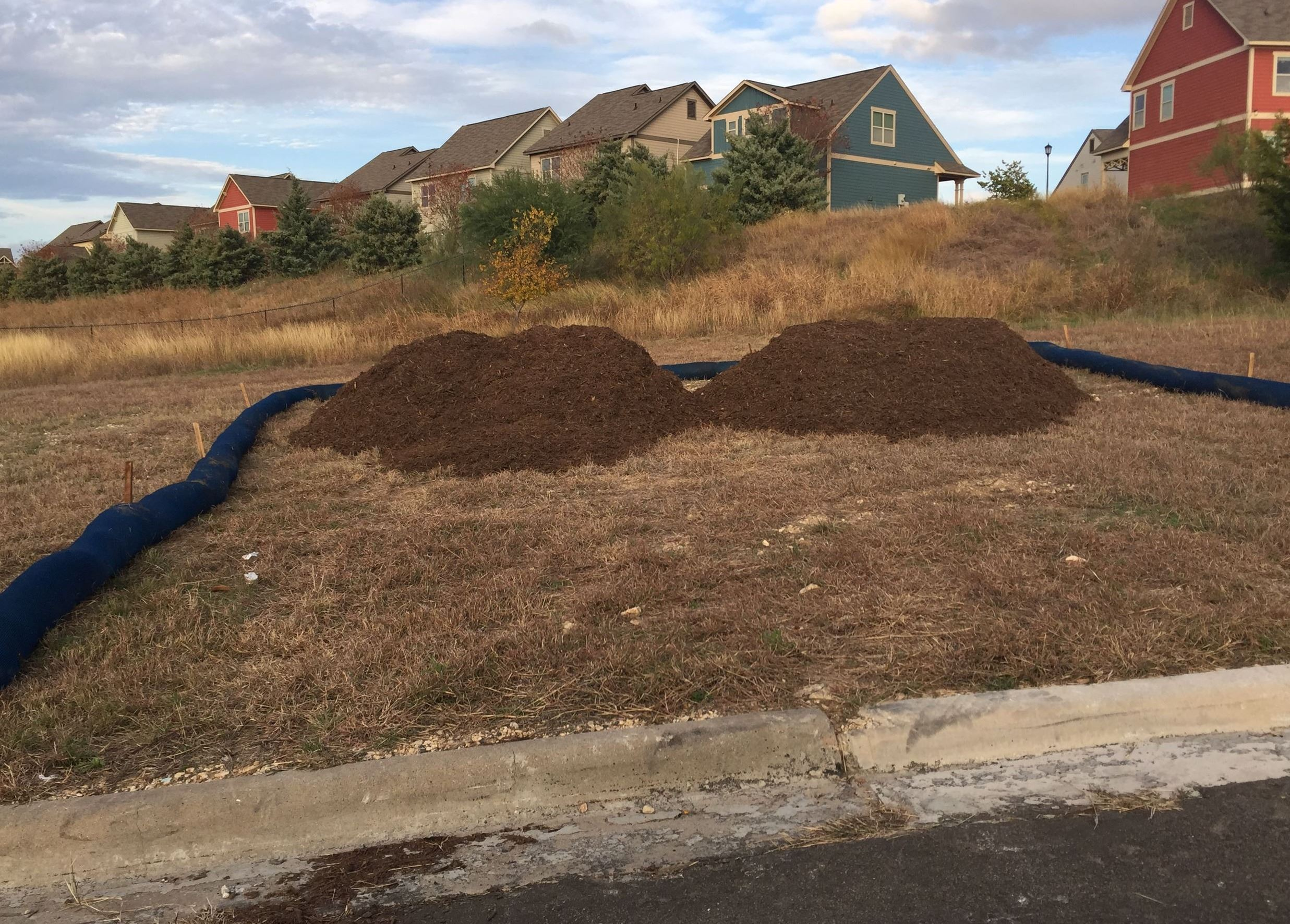 Photo of mulch piles available on Archie St.