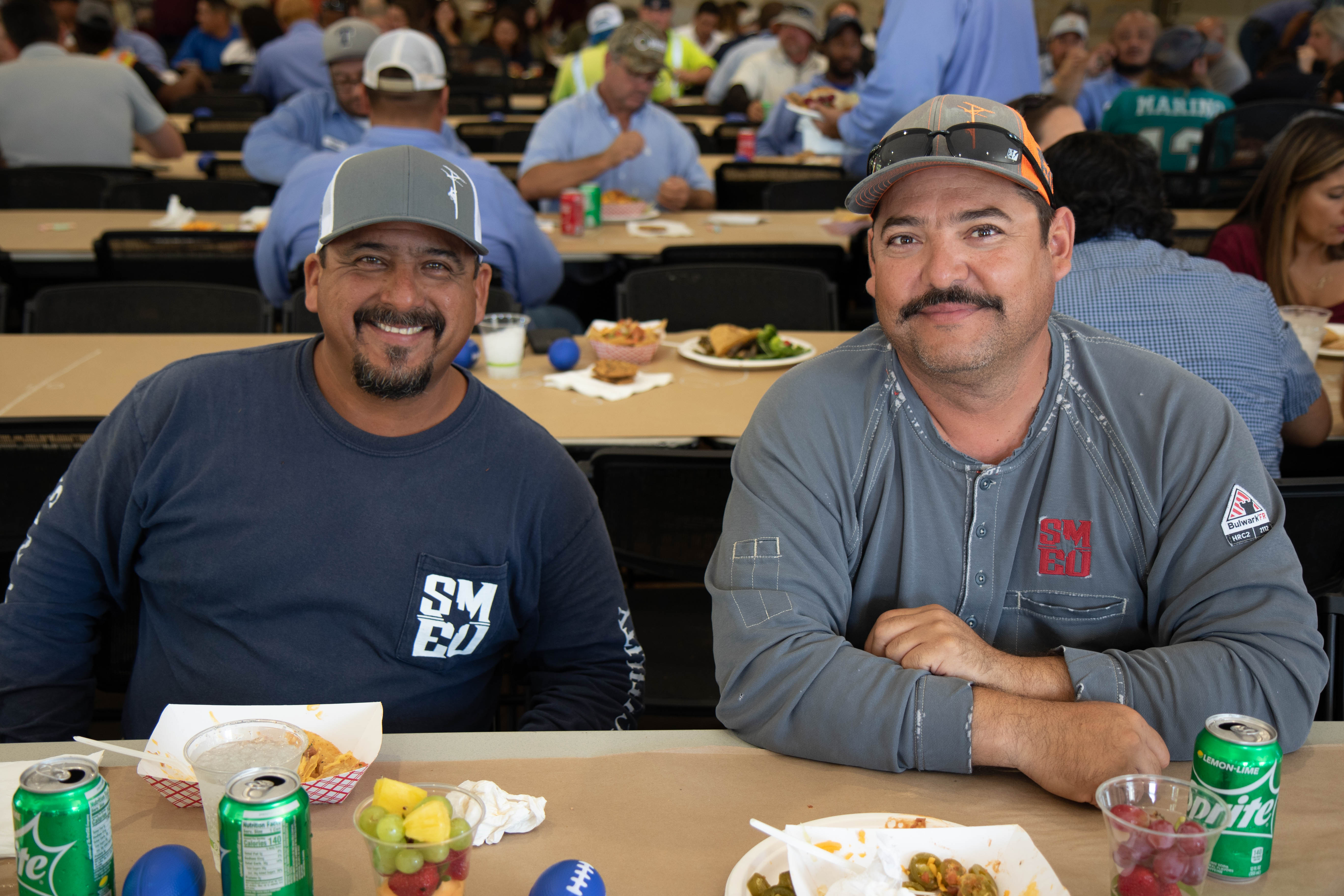 SMEU Team Members eat barbeque at a City Tailgate Party